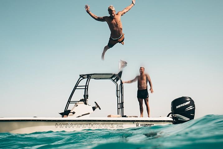 Man Jumping Off Boat